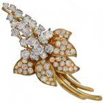 küpe çiçeği modeli altın broş yılın modası