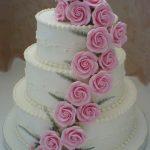 yuvarlak pembe güllü modern düğün pastası